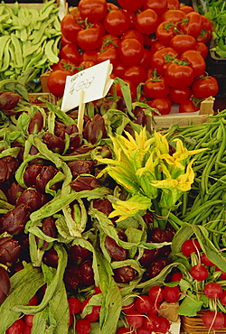 Courgette flowers, artichoke, tomatoes and radishes for sale in the market in Venice, Veneto, Italy, Europe
