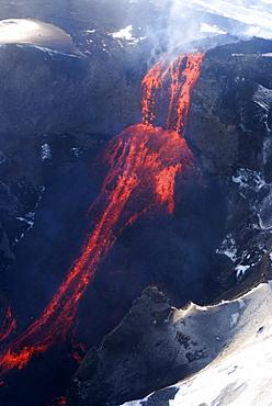 Lava flowing down mountain from Eyjafjallajokull volcano, Iceland, Polar Regions