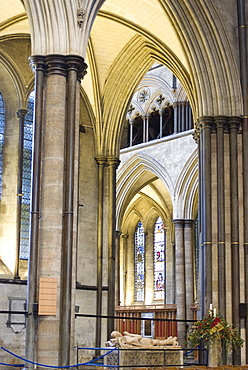 A view of the interior of Salisbury Cathedral with a tomb and effigy of an ancient knight, Salisbury, Wiltshire, England, United Kingdom, Europe