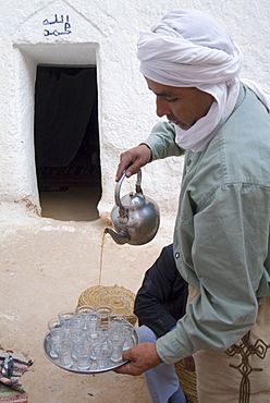 Pouring mint tea in the traditional way, Matmata, Tunisia, North Africa, Africa