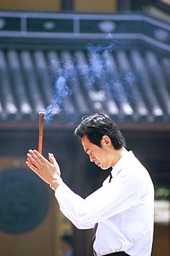 Man praying, Shanghai, China, Asia
