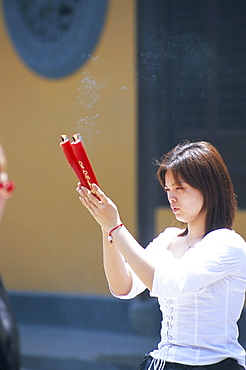 Young woman praying, Shanghai, China, Asia
