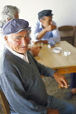 Man in a cafe, Emporio, Santorini (Thira), Cyclades Islands, Greek Islands, Greece, Europe