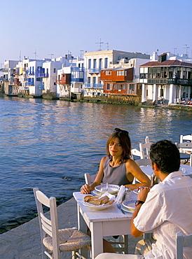 Couple eating at a restaurant, Little Venice, Mykonos Town, Mykonos (Mikonos), Cyclades Islands, Greek Islands, Greece, Europe