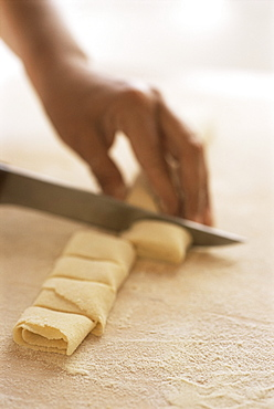 Cutting uncooked pasta into parcel shapes, Arezzo, Tuscany, Italy, Europe