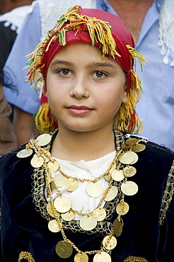 Young girl attending village wedding, Anogia, Crete, Greek Islands, Greece, Europe