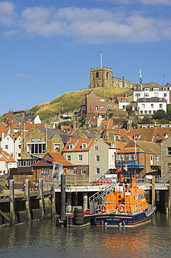 Church and lifeboat in the harbour, Whitby, North Yorkshire, Yorkshire, England, United Kingdom, Europe
