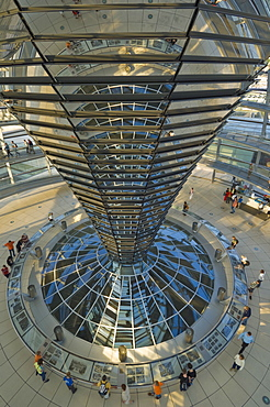 The cone shaped funnel in the dome cupola has 360 glass mirrors reflecting light into the Plenary chamber of the Reichstag building, designed by Sir Norman Foster, Berlin, Germany, Europe