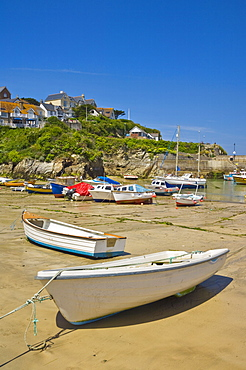Small fishing boats and yachts at low tide, Newquay harbour, Newquay, Cornwall, England, United Kingdom, Europe