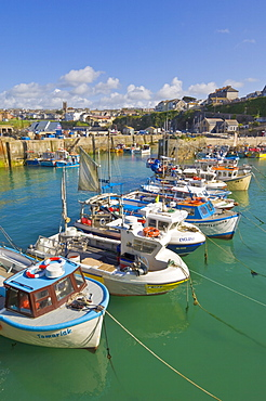 Small fishing boats in the harbour at high tide, Newquay, North Cornwall, England, United Kingdom, Europe
