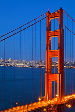 The Golden Gate Bridge, linking the city of San Francisco with Marin County, taken from the Marin Headlands at night with the city in the background and traffic light trails across the bridge, San Francisco, Marin County, California, United States of America, North America