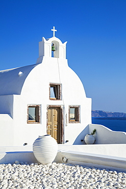 White church of Agios Vasilios overlooking Aegean Sea, Oia, Santorini (Thira), Cyclades Islands, Greek Islands, Greece, Europe