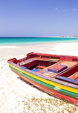 Colourful traditional local fishing boat on the beach at Santa Maria, Praia da Santa Maria, Sal Island, Cape Verde, Atlantic, Africa