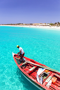 Fisherman with his catch of fish in a traditional fishing boat, Santa Maria, Sal Island, Cape Verde, Atlantic, Africa