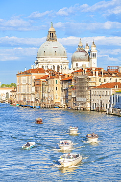 Vaporettos (water taxis) passing the grand church of Santa Maria della Salute, on the Grand Canal, Venice, UNESCO World Heritage Site, Veneto, Italy, Europe
