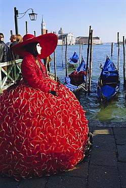 Person wearing masked carnival costume, San Giorgio in the background, Venice Carnival, Venice, Veneto, Italy