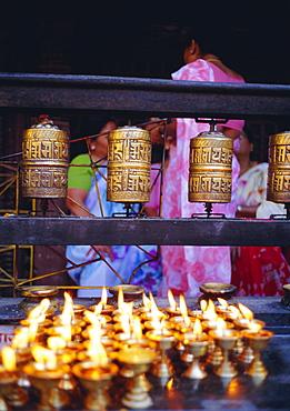 Lamps and prayer wheels, Gold Temple, Patan, Kathmandu Valley, Nepal, Asia