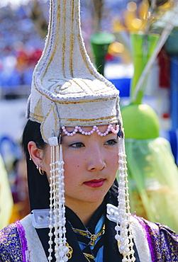 Portrait of a woman at the Naadam Festival, Ulaan Baatar (Ulan Bator), Mongolia, Asia