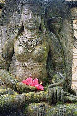 Statue with flower offering, Odalan, ceremony, at Bataun temple, Bali, Indonesia, Asia