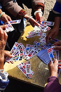 Naxi women playing a local game of cards, Lijiang, Yunnan, China, Asia