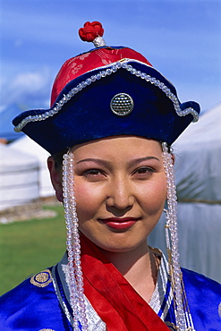 Head and shoulders portrait of a young woman dancer in traditional clothing at Naadam Festival, Altai, Gov-altai, Mongolia, Central Asia, Asia