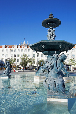 Statues and fountain with elegant buildings beyond, Praca Dom Pedro IV (Rossio Square), Lisbon, Portugal, Europe