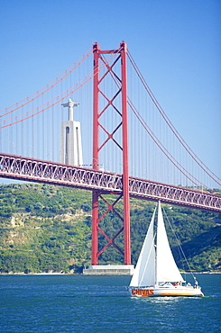 25th April bridge over the Tagus river and the Christ Statue in background, a gift from Brazil, this smaller replica represents the lasting friendship of the former colony), Lisbon, Portugal, Europe