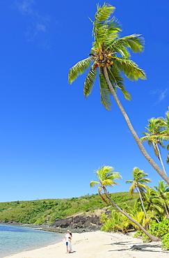 Couple on a tropical beach, Drawaqa Island, Yasawa island group, Fiji, South Pacific islands, Pacific