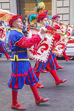 Marching men in costume playing fanfare trumpets during  Scoppio del Carro festival in Florence, Tuscany, Italy, Europe