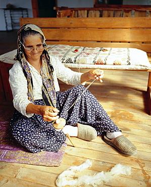 Old Turkish woman sewing a mat, Kekova (Kas), Turkey, Eurasia