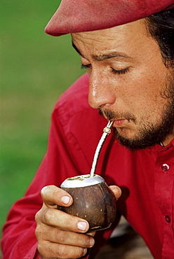 A gaucho drinking mate, Torres del Paine National Park, Patagonia, Chile, South America