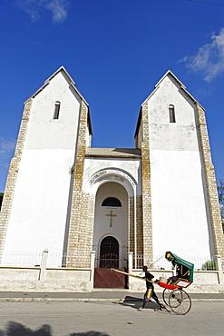 Rickshaw passing Lutheran Church, Toliara (Tulear), capital of the Atsimo-Andrefana region, Madagascar, Africa