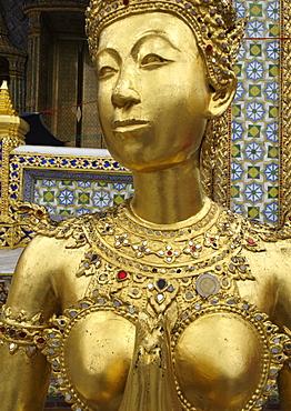 Statue of a kinnara, Wat Phra Kaew temple, Grand Palace. Bangkok, Thailand, Southeast Asia, Asia