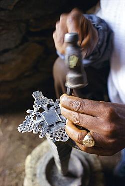 Close-up of blacksmith's hands working on metal cross, Axoum (Axum) (Aksum), Tigre region, Ethiopia, Africa