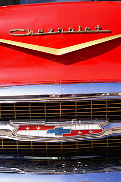 Close-up of grille on front of red Chevrolet car, United States of America (U.S.A.), North America