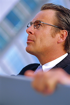 Portrait of a business man wearing glasses