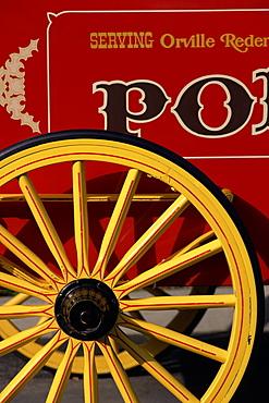 Close-up of yellow wheel on red cart, Disney MGM Studios, Orlando, Florida, United States of America (U.S.A.), North America