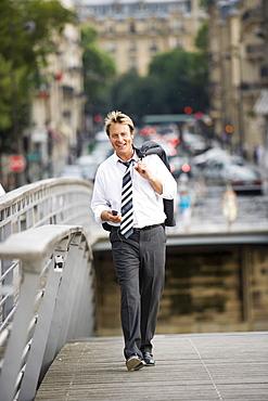 Business man on bridge, Paris, France, Europe