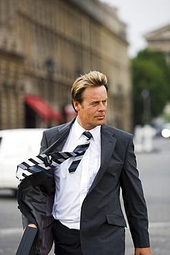 Business man crossing road, Paris, France, Europe