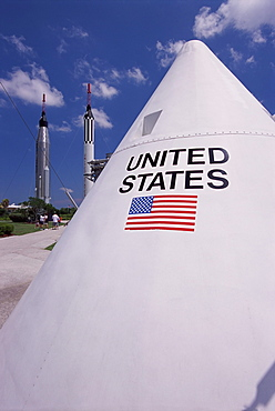 Close-up of American flag, with rockets behind, Space Museum (Kennedy Space Center), Florida, United States of America (U.S.A.), North America