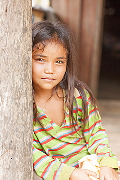 Girl in doorway, Laos, Indochina, Southeast Asia, Asia
