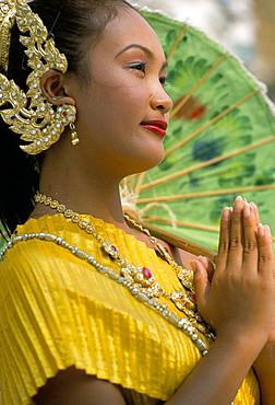 Portrait of a young woman with hands together in greeting, Bangkok, Thailand, Southeast Asia, Asia