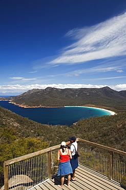Tourists admiring the view of Wineglass Bay, Coles Bay, Freycinet Peninsula, Freycinet National Park,Tasmania, Australia, Pacific