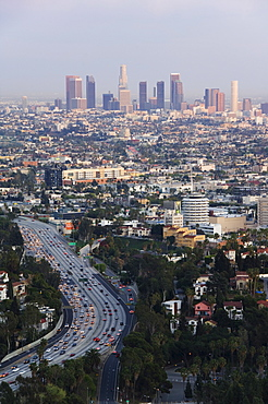 Downtown district skyscrapers and cars on a city highway, Los Angeles, California, United States of America, North America