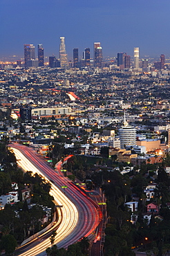 Downtown district skyscrapers and car lights on a city highway, Los Angeles, California, United States of America, North America
