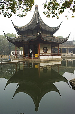 A pagoda reflected in the water at West Garden Buddhist Temple, Suzhou, Jiangsu Province, China, Asia