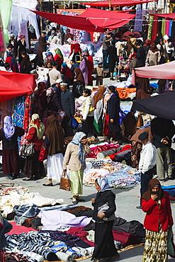 Silk fabrics being sold at the Sunday market, Kashgar (Kashi) city, Xinjiang Provice, China, Asia