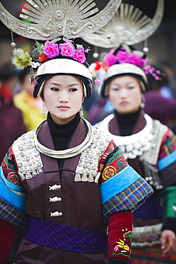Women in ethnic costume at a Lunar New Year festival in the Miao village of Qingman, Guizhou Province, China, Asia