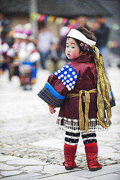 A girl in ethnic costume at a Lunar New Year festival in the Miao village of Qingman, Guizhou Province, China, Asia