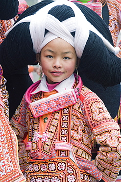 Long Horn Miao girl at lunar New Year festival celebrations in Sugao ethnic village, Guizhou Province, China, Asia